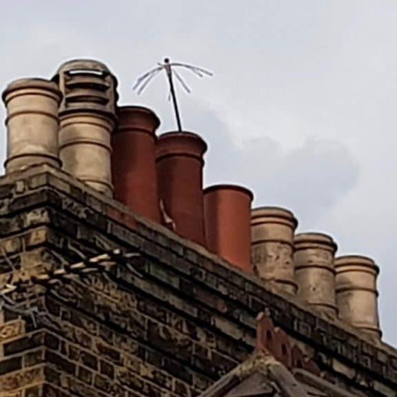 Chimney Sweeping rods showing through chimney pot