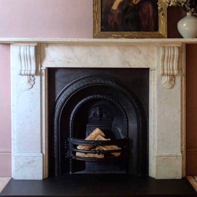 Timeless elegance with a traditional Carrara marble fireplace mantel. Fitted by Casa in Camberwell, London, SE5