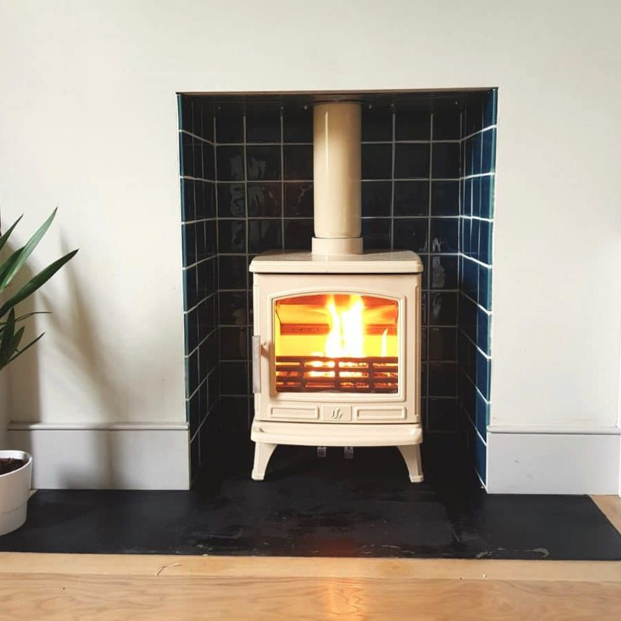 Front view of Eco Design Ready ACR Oakdale wood burning stove, in Buttermilk Enamel, installed in Penge, London SE20