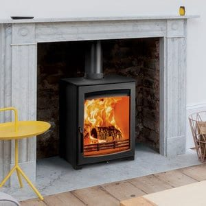 Aspect 5 compact eco wood burning stove down with a Georgian mantle